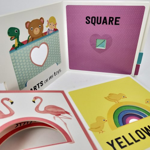 A PEEP-THROUGH Book About  Shapes  Colours